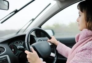 woman-in-pink-coat-driving-a-car